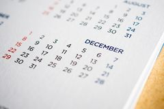 December calendar page with months and dates. Close up royalty free stock photo