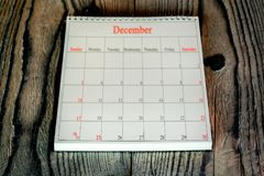 A December 25. December 25 in the calendar on the wood background Stock Image