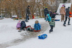 December 18, 2016: Children sledding down the hills. Cheboksary. Stock Photography