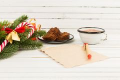 December Christmas letter concept with cake and hot chocolate. On white wood table Stock Photo