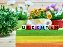 December. Colorful cube letters on sticky note block. royalty free stock image