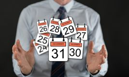 Concept of 31 december. 31 december concept between hands of a man in background Stock Image