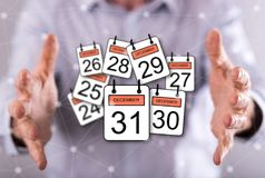 Concept of 31 december. 31 december concept between hands of a man in background Royalty Free Stock Images
