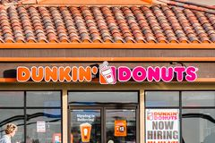 December 17, 2018 Half Moon Bay / CA / USA - Dunkin` Donuts sign above the entrance to the location in Half Moon Bay stock photos