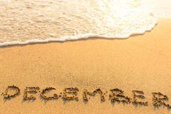 December - inscription on sand beach Stock Photo