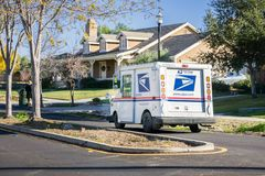 December 12, 2017 Livermore / CA / USA - USPS vehicle driving through a residential neighborhood on a sunny day stock photo