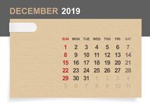 December 2019 - Monthly calendar on brown paper and wood background with area for note. Vector illustration stock illustration