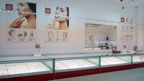 December 30, 2017, Mtsensk, Russia, Editorial - Showcase of a jewelry store. Silver and gold items with precious stones. December 30, 2017, Mtsensk, Russia stock footage