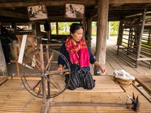 December,25 2017. Old women demonstrate to procedure of making Thai Silk at Jim Thompson`s Farm stock image
