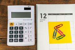 December organizer with calculator. & clips: concept for monthly budget Royalty Free Stock Image