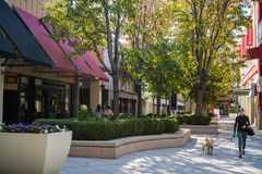 December 7, 2017 Palo Alto / CA / USA - Walking through the open air Stanford shopping center, San Francisco bay area stock photography