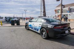 December 24, 2017 Pismo Beach / CA / USA - Custom panted police car parked close to the beach stock image