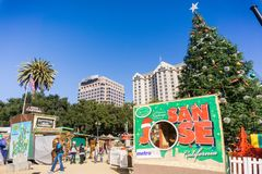 December 6, 2017 San Jose / CA / USA - People entering Christmas in the park downtown display in Plaza de Cesar Chavez, Silico. N Valley, south San Francisco bay royalty free stock photos