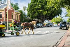 December 24, 2017 San Luis Obispo / CA / USA - Horse-drawn carriage taking people for a tour around the historical part of the. City stock images