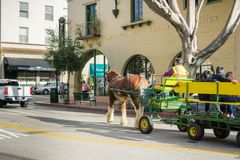 December 24, 2017 San Luis Obispo / CA / USA - Horse-drawn carriage taking people for a tour around the historical part of the. City; The Visitor Information royalty free stock images