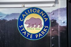 December 23, 2017 San Simeon / CA / USA - California State Parks logo on a tour bus door stock photo