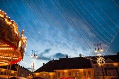 24 December 2014 SIBIU, ROMANIA. Christmas lights, Christmas fair, mood and people walking. Fish eye lens effects stock image