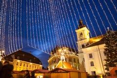 24 December 2014 SIBIU, ROMANIA. Christmas lights, Christmas fair, mood and people walking. Fish eye lens effects stock images