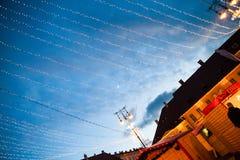 24 December 2014 SIBIU, ROMANIA. Christmas lights, Christmas fair, mood and people walking. Fish eye lens effects royalty free stock images