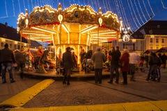 24 December 2014 SIBIU, ROMANIA. Christmas lights, Christmas fair, mood and people walking. Fish eye lens effects stock photography