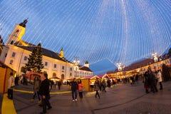 24 December 2014 SIBIU, ROMANIA. Christmas lights, Christmas fair, mood and people walking. Fish eye lens effects royalty free stock photography