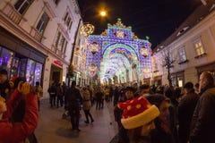 24 December 2014 SIBIU, ROMANIA. Christmas lights, Christmas fair, mood and people walking Stock Images