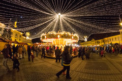 24 December 2014 SIBIU, ROMANIA. Christmas lights, Christmas fair, mood and people walking Royalty Free Stock Photography