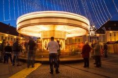 24 December 2014 SIBIU, ROMANIA. Christmas lights, Christmas fair, mood and people walking. Fish eye lens effects royalty free stock image