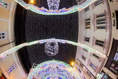 24 December 2014 SIBIU, ROMANIA. Christmas lights, Christmas fair, mood and people walking. Fish eye lens effects stock photos
