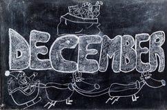 December som är handskriven på svart tavla Fotografering för Bildbyråer