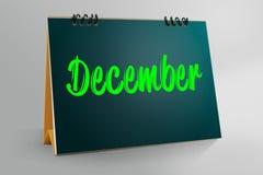 December som är skriftlig i skrivbords- kalender Arkivfoton