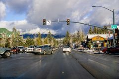 December 25, 2018 South Lake Tahoe / CA / USA - Driving through South Lake Tahoe on a sunny day; storm clouds gathering the the. Background royalty free stock photos