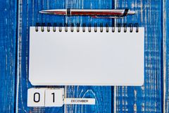 December 1st. Day 1 of month, calendar on blue background. Royalty Free Stock Photo