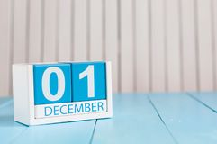 December 1st. Day 1 of month, calendar on wooden background. Winter time. Empty space for text.  stock photo