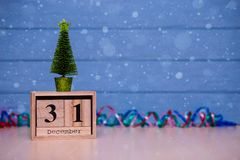 December 31st. Day 31 of December set on wooden calendar on blue wooden plank background. Winter time. New year background. Christmas Holiday Composition Stock Photo