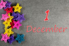 December 1st. Image 1 day of december month, calendar with stars - toy for Christmas tree. New year background Stock Photos