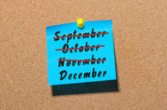 December start and end of November, October, September concept, written on blue paper pinned at notice board. Eve Royalty Free Stock Images
