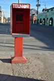 Old technology empty telephone booth San Felipe, Baja, Mexico. December 25th 2017, Christmas Day deserted street with abandoned telephone booth with pay phone Stock Photo