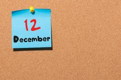 December 12th. Day 12 of month, Calendar on cork notice board. Winter time. Empty space for text.  stock photo