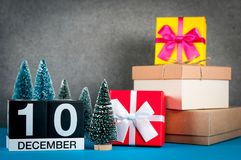 December 10th. Image 10 day of december month, calendar at christmas and new year background with gifts and little. Christmas tree stock photo