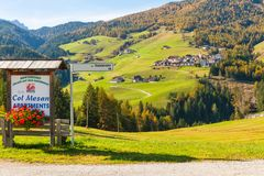 San Martino in Badia panoramic view. December 2014 during this time of year tourists walking along the paths of the beautiful val gardena take rest in cozy Stock Images