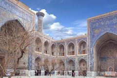 December 2018, Uzbekistan, Samarkand, Registan Square, Madrasa Sherdor `Resident of the Lions`. Whith symbol of power depicted on the portal - leopards with the royalty free stock image