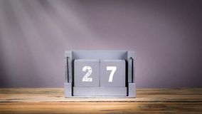 27 December wooden calendar in motion. 27 December. wooden calendar in motion. communication and marketing background stock video