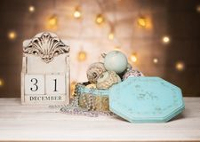 December 31 wooden calendar and vintage New Year balls toys. New year greeting card stock image