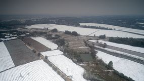 Aerial photography of the snowy scenery of ten thousand mu tea garden in Xuancheng, Anhui Province, China. On December 9, 2018, in Xuancheng, Anhui Province stock image
