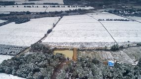 Aerial photography of the snowy scenery of ten thousand mu tea garden in Xuancheng, Anhui Province, China. On December 9, 2018, in Xuancheng, Anhui Province stock images