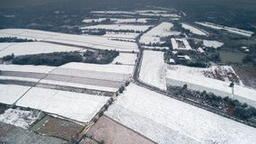 Aerial photography of the snowy scenery of ten thousand mu tea garden in Xuancheng, Anhui Province, China. On December 9, 2018, in Xuancheng, Anhui Province royalty free stock photos
