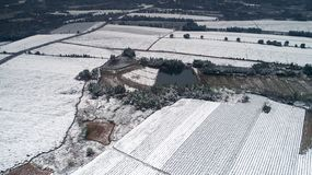Aerial photography of the snowy scenery of ten thousand mu tea garden in Xuancheng, Anhui Province, China. On December 9, 2018, in Xuancheng, Anhui Province stock photo