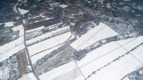 Aerial photography of the snowy scenery of ten thousand mu tea garden in Xuancheng, Anhui Province, China. On December 9, 2018, in Xuancheng, Anhui Province royalty free stock images