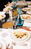 Decemberdinner with entree on plates Stock Photography